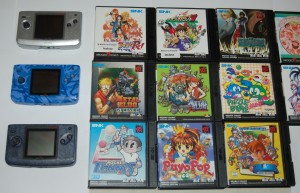 3 Neo Geo Pocket consoles and their games